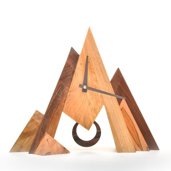 Blowing Rock Clock variations of wood